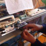 qui indique aux artisans le nombre de mailles avant de changer de couleurs de laine pour obtenir des motifs